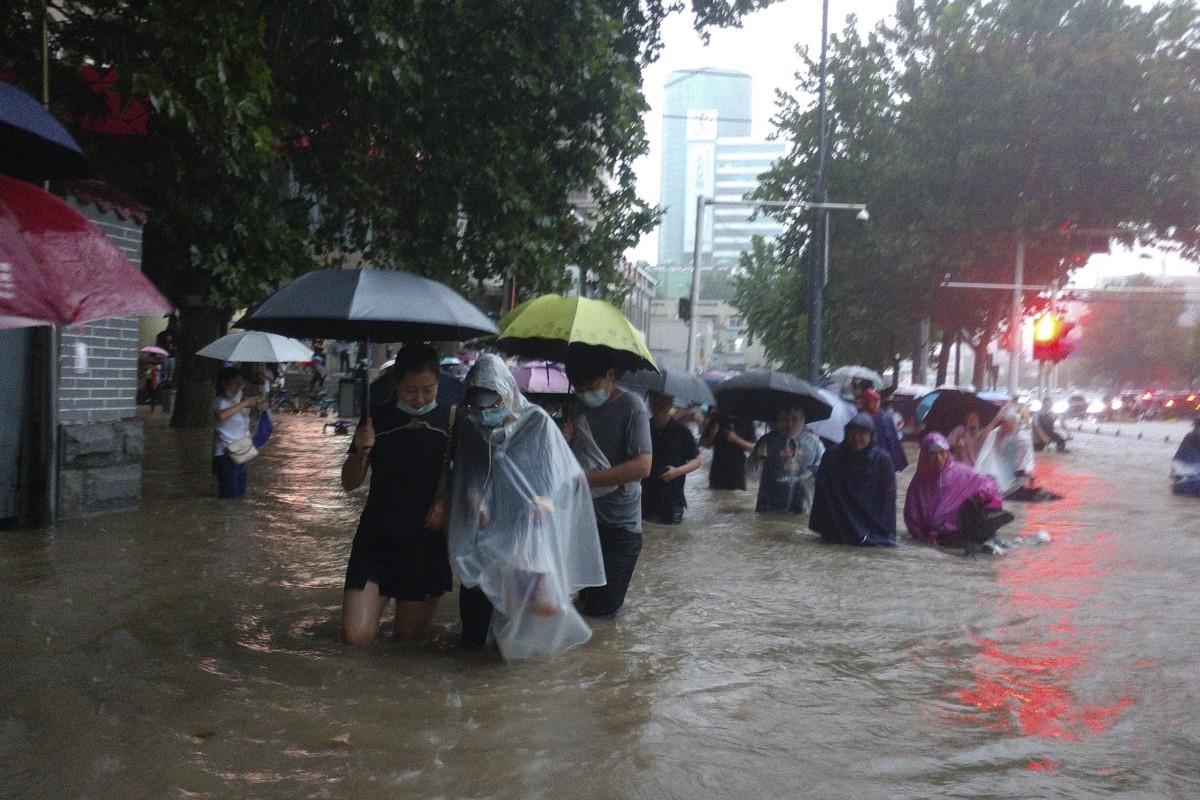 Severe floods rage through China's Zhengzhou killing 12, thousands evacuated