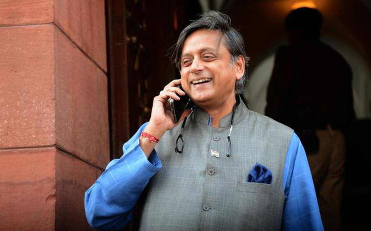 Tharoor's coconut smashing pictures goes viral, here's his 4 favorite memes
