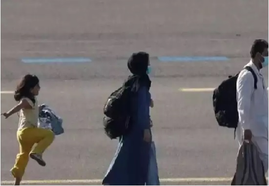 Picture of the innocent girl smiling at Belgium Airport after coming out of the clutches of the Taliban gets viral on social media