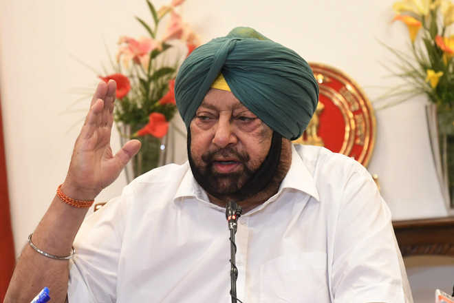 Punjab CM flays Badal's for playing a double game on farm laws