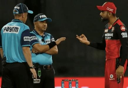 IPL 2021, RCB vs KKR: Virat Kohli involved in heated exchange with umpire, throws ball in frustration