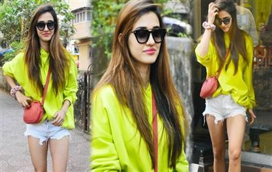 Disha Patani turns casual in oversized neon sweatshirt and distressed shorts. See Pics