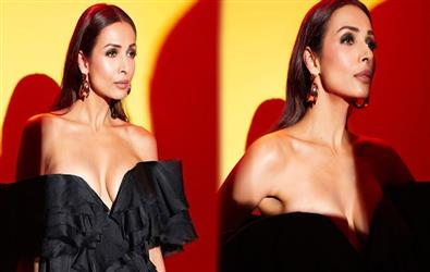 Malaika Arora bold photoshoot in all-black off-shoulder top and flare pants. See Pics